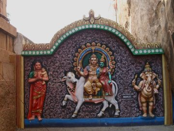 Colourful Sculpture Of Mata Parvati With Her Family On Wall