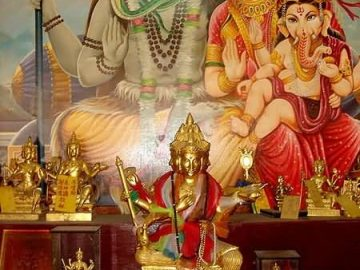 Shiva Parvati Ganesha and Four-faced Buddha inside a temple in Taiwan